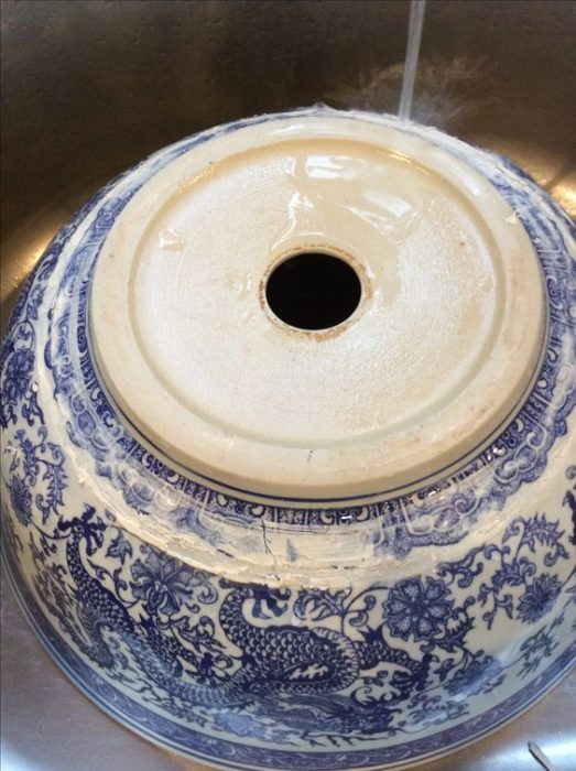 blue and white vessel sink
